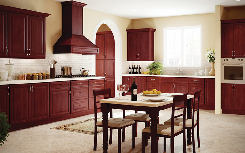 Cherry-K Dark cherry cabinets in a warm kitchen